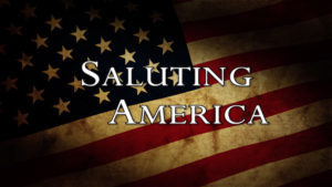 "American flag with text: ""Saluting America"""