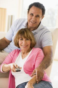 couple-in-living-room-with-remote-control-smiling_0.jpg